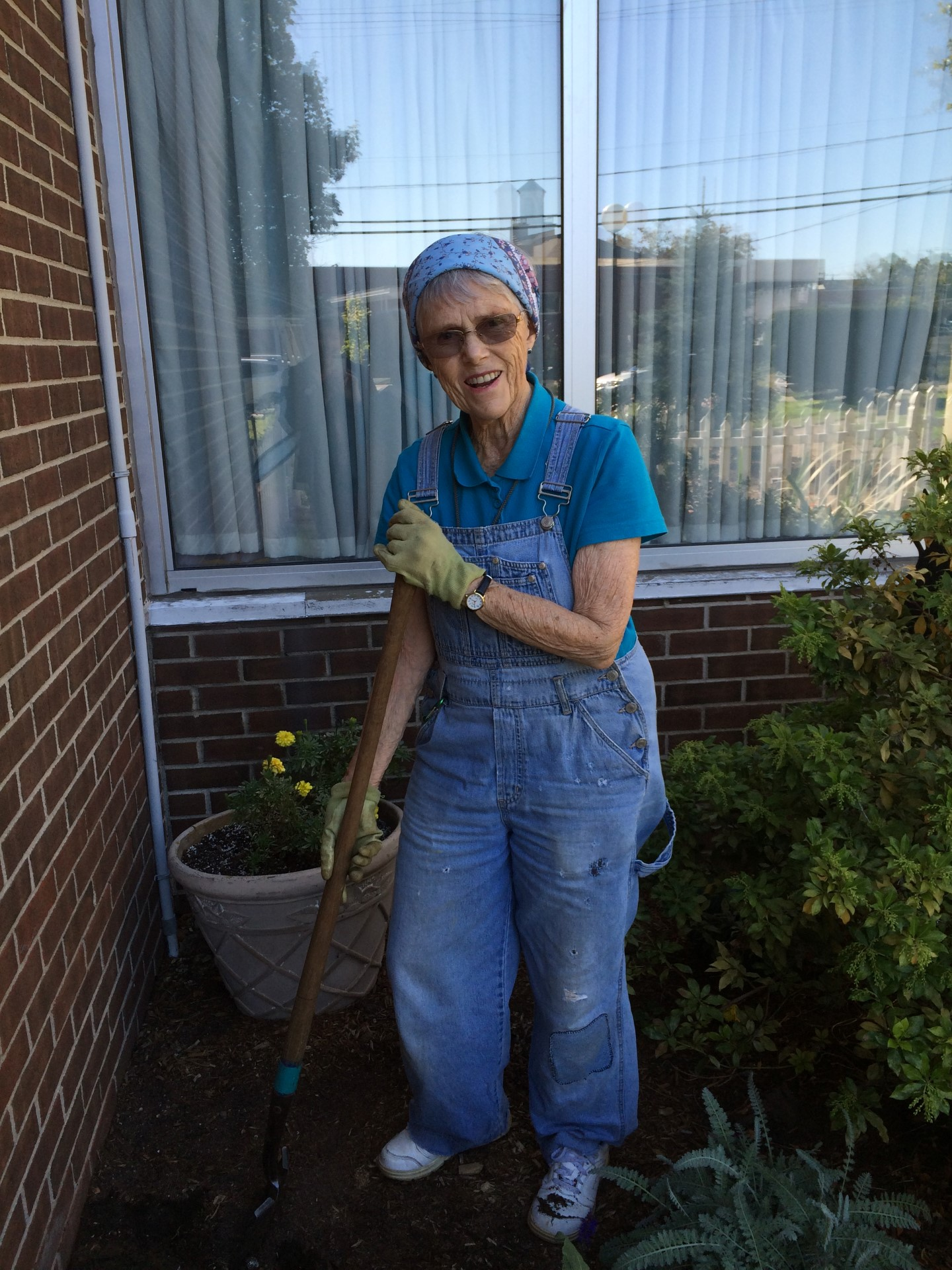 Joan raking in the Spring