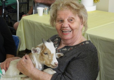 Emma Aglione holding a goat at the visiting petting zoo